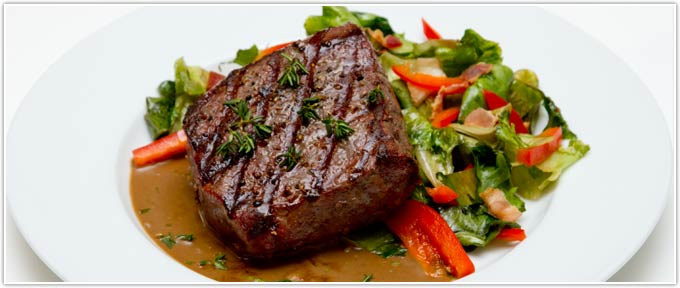 Sirloin Filets With Wilted Escarole, Red Peppers, Bacon & Balsamic-Scallion Vinaigrette