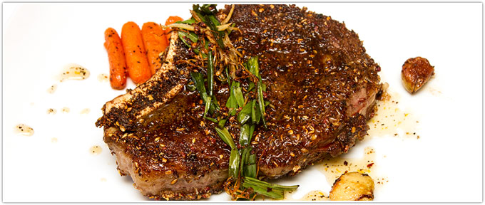 Spice-Crusted Cowboy Ribeye With Chili-Orange Glazed Carrots