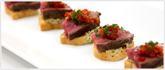 Steak Crostini With Vinegar Peppers & Pesto Cheese