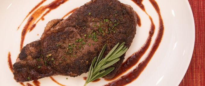 Tuscan-Spiced Ribeye With Red Wine Tomato Sauce
